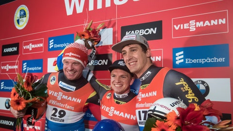 <p>               Winner Wolfgang Kindl, center, of Austria, is flanked by second-place Felix Loch, left, of Germany, and third-place Reinhard Egger, right, at the World Cup men's luge event in Whistler, British Columbia, Friday, Nov. 30, 2018. (Darryl Dyck/The Canadian Press via AP)             </p>