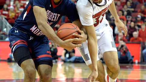 <p>               Robert Morris forward Charles Bain (20) strips the ball from Louisville forward Jordan Nwora (33) during the second half of an NCAA college basketball game in Louisville, Ky., Friday, Dec. 21, 2018. (AP Photo/Timothy D. Easley)             </p>