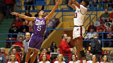 <p>               Texas Tech's Jarrett Culver (23) shoots the ball over Abilene Christian's Payten Ricks (5) during the first half of an NCAA college basketball game Saturday, Dec. 15, 2018, in Lubbock, Texas. (AP Photo/Brad Tollefson)             </p>