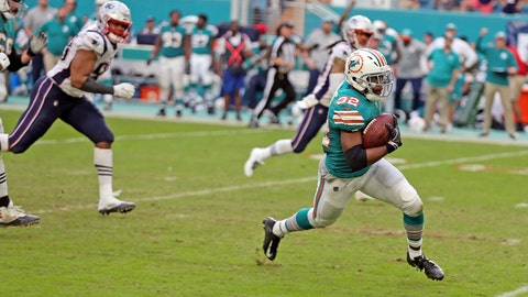 <p>               Miami Dolphins running back Kenyan Drake (32) runs for a touchdown during the second half of an NFL football game against the New England Patriots, Sunday, Dec. 9, 2018, in Miami Gardens, Fla. The Dolphins defeated the Patriots 34-33. (Charles Trainor Jr./Miami Herald via AP)             </p>