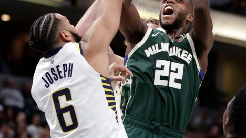 <p>               Milwaukee Bucks forward Khris Middleton (22) shoots over Indiana Pacers guard Cory Joseph (6) during the second half of an NBA basketball game in Indianapolis, Wednesday, Dec. 12, 2018. The Pacers defeated the Bucks 113-97. (AP Photo/Michael Conroy)             </p>