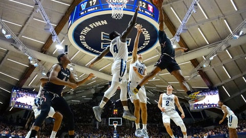 <p>               Temple's Nate Pierre-Louis (15) goes up for a shot against Villanova's Cole Swider (10) and Eric Paschall (4) during the first half of an NCAA college basketball game, Wednesday, Dec. 5, 2018, in Villanova, Pa. (AP Photo/Matt Slocum)             </p>