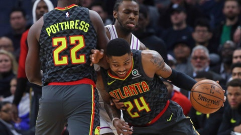<p>               Atlanta Hawks' Kent Bazemore, right, drives as Atlanta Hawks' Alex Poythress, left, sets a pick on Minnesota Timberwolves' Andrew Wiggins during the first half of an NBA basketball game Friday, Dec. 28, 2018, in Minneapolis. (AP Photo/Jim Mone)             </p>