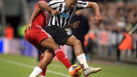 <p>               Fulham's Denis Odoi, left, and Newcastle United's Salomon Rondon battle for the ball during the English Premier League soccer match between Newcastle United and Fulham at St James' Park, Newcastle, England. Saturday, Dec. 22, 2018. (Owen Humphreys/PA via AP)             </p>