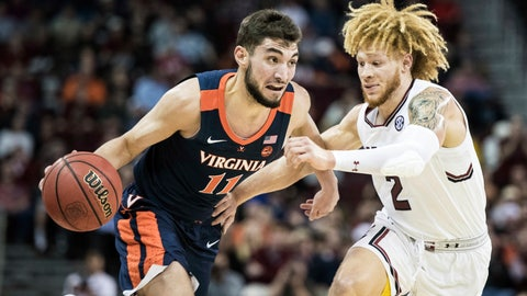 <p>               Virginia guard Ty Jerome (11) dribbles the ball against South Carolina guard Hassani Gravett (2) during the first half of an NCAA college basketball game Wednesday, Dec. 19, 2018, in Columbia, S.C. (AP Photo/Sean Rayford)             </p>