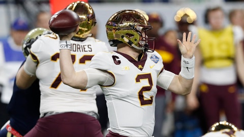 <p>               Minnesota quarterback Tanner Morgan (2) throws a pass during the first half of the Quick Lane Bowl NCAA college football game against Georgia Tech, Wednesday, Dec. 26, 2018, in Detroit. (AP Photo/Carlos Osorio)             </p>