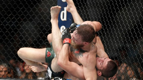 <p>               FILE - In this Oct. 7, 2018, file photo, Khabib Nurmagomedov, right, takes down Conor McGregor during a lightweight title mixed martial arts bout at UFC 229 in Las Vegas, Nevada fight regulators postponed until next month hearings on suspensions against UFC fighters Conor McGregor and Khabib Nurmagomedov for a brawl after their October match in Las Vegas. (AP Photo/John Locher, File)             </p>