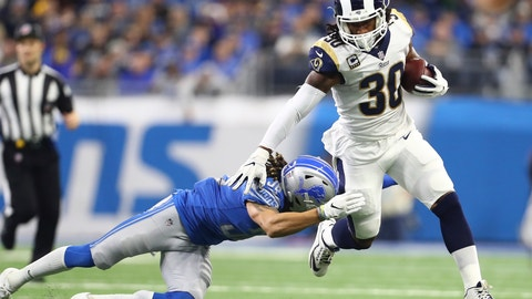 <p>               FILE - In this Sunday, Dec. 2, 2018, file photo, Los Angeles Rams running back Todd Gurley (30) pulls away from Detroit Lions defensive back Mike Ford during the first half of an NFL football game in Detroit. Gurley finds himself in exclusive company. He has gained 1,649 yards from scrimmage and scored 19 TDs so far this season. Only six players have topped those marks in the first 12 games. (AP Photo/Rey Del Rio, File)             </p>