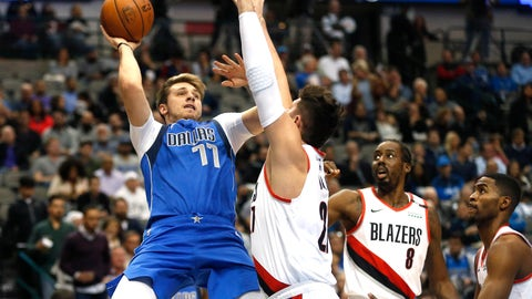 <p>               Dallas Mavericks forward Luka Doncic (77) attempts a shot over Portland Trail Blazers center Jusuf Nurkic (27) as Portland Trail Blazers Al-Farouq Aminu (8) and Maurice Harkless (4) look on during the first half of an NBA basketball game, Tuesday, Dec. 4, 2018, in Dallas. (AP Photo/Ron Jenkins)             </p>