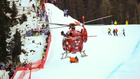 <p>               A rescue helicopter leaves with on board Switzerland's Marc Gisin after he crashed on the course during a men's World Cup downhill, in Val Gardena, Italy, Saturday, Dec. 15, 2018. (AP Photo/Marco Trovati)             </p>