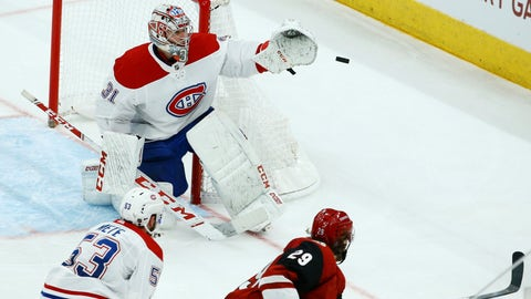 <p>               Montreal Canadiens goaltender Carey Price (31) swats away a shot from Arizona Coyotes right wing Mario Kempe (29) as Canadiens defenseman Victor Mete (53) looks on during the third period of an NHL hockey game Thursday, Dec. 20, 2018, in Glendale, Ariz. The Canadiens defeated the Coyotes 2-1. (AP Photo/Ross D. Franklin)             </p>