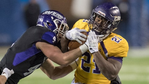 <p>               FILE - In this Dec. 15, 2017, file photo, Mount Union's Danny Robinson (4) tackles Mary Hardin-Baylor's Markeith Miller (21) during the Amos Alonzo Stagg Bowl NCAA Division III college football championship,  in Salem, Va. Robinson and Miller were named to The Associated Press Division III All-America Team, Thursday, Dec. 13, 2018. (AP Photo/Lee Luther Jr., File)             </p>
