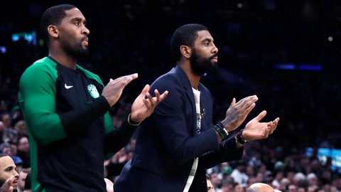 <p>               Boston Celtics guard Kyrie Irving, right, who did not play due to an injury, and guard Brad Wanamaker, left, applaud teammates during the first quarter of a basketball game against the New Orleans Pelicans in Boston, Monday, Dec. 10, 2018. (AP Photo/Charles Krupa)             </p>