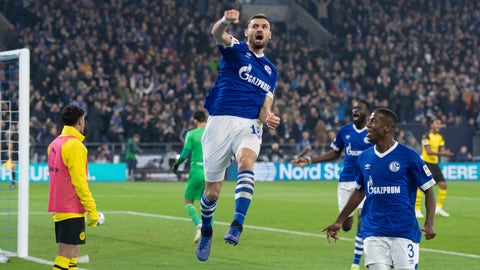 <p>               Schalke's Daniel Caligiuri , front, celebrates after scoring his side's first goal in the German Bundesliga soccer match between FC Schalke 04 and Borussia Dortmund in Gelsenkirchen, western Germany, Saturday, Dec. 8, 2018. (Bernd Thissen/dpa via AP)             </p>