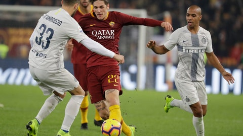 <p>               Roma's Nicolo Zaniolo, center, challenges for the ball with Inter Milan's Danilo D'Ambrosio, left, and Inter Milan's Joao Mario during the Serie A soccer match between Roma and Inter Milan at the Rome Olympic stadium, Monday, Dec. 3, 2018. (AP Photo/Andrew Medichini)             </p>