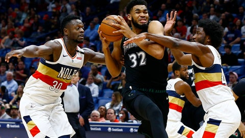 <p>               Minnesota Timberwolves center Karl-Anthony Towns (32) drives to the basket as New Orleans Pelicans forwards Julius Randle (30) and Solomon Hill (44) defend during the first half of an NBA basketball game, Monday, Dec. 31, 2018, in New Orleans. (AP Photo/Butch Dill)             </p>