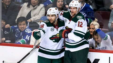 <p>               Minnesota Wild's Jason Zucker, left, and Eric Staal celebrate Zucker's second goal against the Vancouver Canucks during the second period of an NHL hockey game, Tuesday, Dec. 4, 2018, in Vancouver, British Columbia. (Darryl Dyck/The Canadian Press via AP)             </p>