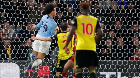 <p>               Manchester City's Leroy Sane, left, scores his side's opening goal during the English Premier League soccer match between Watford and Manchester City at Vicarage Road stadium in Watford, England, Tuesday, Dec. 4, 2018. (AP Photo/Frank Augstein)             </p>