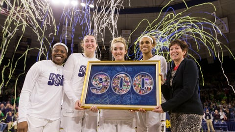 <p>               Notre Dame head coach Muffet McGraw, right, stands with players Arike Ogunbowale, left, Jessica Shepard, second from left, Marina Mabrey, center, and Brianna Turner as they pose for photos during a celebration of McGraw's 900th career win following Notre Dame's victory over Lehigh in an NCAA college basketball game Sunday, Dec. 30, 2018, in South Bend, Ind. (AP Photo/Robert Franklin)             </p>