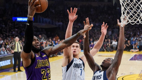 <p>               Los Angeles Lakers forward LeBron James, left, shoots as Dallas Mavericks forward Dwight Powell, center, and forward Dorian Finney-Smith defend during the first half of an NBA basketball game Friday, Nov. 30, 2018, in Los Angeles. (AP Photo/Mark J. Terrill)             </p>