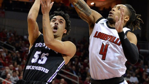 <p>               Louisville guard Khwan Fore (4) attempts to block the shot of Central Arkansas guard DeAndre Jones (55) during the first half of an NCAA college basketball game, in Louisville, Ky., Wednesday, Dec. 5, 2018. (AP Photo/Timothy D. Easley)             </p>