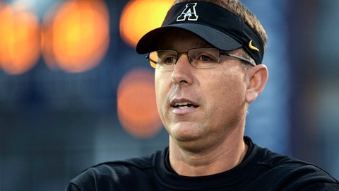 """<p>               File-This Oct. 25, 2018, file photo shows Appalachian State head coach Scott Satterfield watches his team warm up before an NCAA college football game against the Georgia Southern, in Statesboro, Ga. A person with knowledge of the situation says Louisville has reached agreement with Satterfield to be the Cardinals next head football coach. The person spoke to The Associated Press Monday, Dec. 3, 2018, on condition on anonymity because neither the school nor Satterfield had publicly announced the decision. Louisville has scheduled a Tuesday afternoon news conference with a """"special announcement"""" about the football program. (AP Photo/John Amis, File)             </p>"""