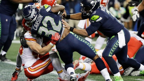 <p>               Seattle Seahawks running back Chris Carson (32) scores a touchdown against the Kansas City Chiefs as quarterback Russell Wilson, right, pushes during the second half of an NFL football game, Sunday, Dec. 23, 2018, in Seattle. (AP Photo/Elaine Thompson)             </p>