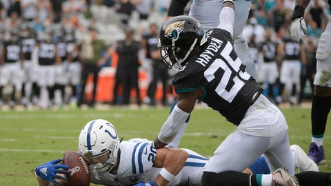 <p>               Jacksonville Jaguars defensive back D.J. Hayden (25) signals for a first down after he stopped Indianapolis Colts running back Jordan Wilkins, left, short of the goal line on a fourth and one run during the first half of an NFL football game, Sunday, Dec. 2, 2018, in Jacksonville, Fla. (AP Photo/Phelan M. Ebenhack)             </p>