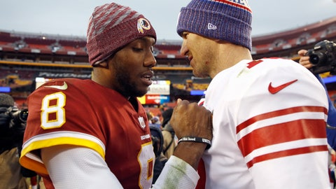 <p>               Washington Redskins quarterback Josh Johnson (8) talks with New York Giants quarterback Eli Manning, right, after an NFL football game Sunday, Dec. 9, 2018, in Landover, Md. (AP Photo/Patrick Semansky)             </p>