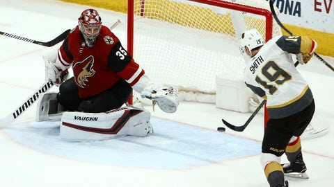 <p>               Vegas Golden Knights right wing Reilly Smith (19) scores a goal against Arizona Coyotes goaltender Darcy Kuemper (35) during the second period of an NHL hockey game Sunday, Dec. 30, 2018, in Glendale, Ariz. (AP Photo/Ross D. Franklin)             </p>