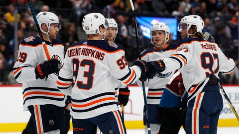 <p>               Edmonton Oilers center Ryan Nugent-Hopkins, center, is congratulated after scoring a goal by centers Leon Draisaitl, left, and Connor McDavid in the second period of an NHL hockey game against the Colorado Avalanche, Tuesday, Dec. 11, 2018, in Denver. (AP Photo/David Zalubowski)             </p>