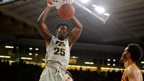 <p>               Iowa forward Tyler Cook (25) dunks over Iowa State guard Nick Weiler-Babb during the second half of an NCAA college basketball game, Thursday, Dec. 6, 2018, in Iowa City, Iowa. (AP Photo/Charlie Neibergall)             </p>