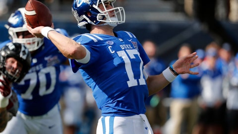 <p>               Duke quarterback Daniel Jones (17) sets to pass against Temple during the first half of the Independence Bowl, an NCAA college football game in Shreveport, La., Thursday, Dec. 27, 2018. (AP Photo/Rogelio V. Solis)             </p>