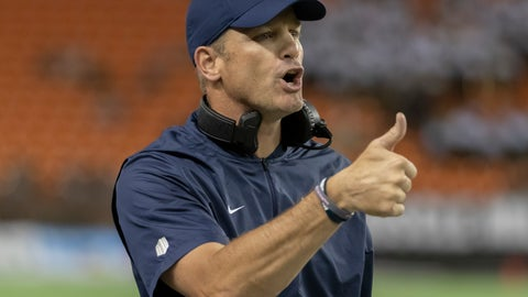 <p>               FILE - In this Nov. 3, 2018, file photo, Utah State coach Matt Wells gestures to officials during the first half of the team's NCAA college football game against Hawaii in Honolulu. Texas Tech has hired Wells as its new football coach after he was part of an impressive turnaround at Utah State, his alma mater. The hiring was announced by Texas Tech on Thursday night, Nov. 29. (AP Photo/Eugene Tanner, File)             </p>
