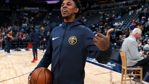 <p>               Denver Nuggets guard Nick Young jokes with members of the Dallas Mavericks before the first half of an NBA basketball game Tuesday, Dec. 18, 2018, in Denver. (AP Photo/David Zalubowski)             </p>