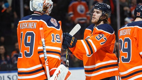 <p>               Edmonton Oilers goalie Mikko Koskinen (19) and Connor McDavid (97) celebrate the win over the Philadelphia Flyers during the third period of an NHL hockey game in Edmonton, Alberta, on Friday, Dec. 14, 2018. (Jason Franson/The Canadian Press via AP)             </p>