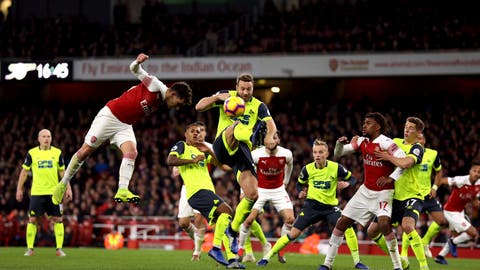 <p>               Arsenal's Lucas Torreira, left, heads the ball towards goal, during the English Premier League soccer match between Arsenal and Huddersfield, at the Emirates Stadium, London, Saturday, Dec. 8, 2018. (Isabel Infantes/PA via AP)             </p>