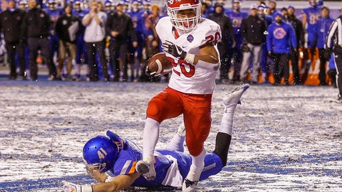 <p>               Fresno State running back Ronnie Rivers (20) runs past the diving tackle attempt by Boise State linebacker Will Heffner (41) for a touchdown in overtime in an NCAA college football game for the Mountain West championship, Saturday, Dec. 1, 2018, in Boise, Idaho. Fresno State won 19-16. (AP Photo/Steve Conner)             </p>