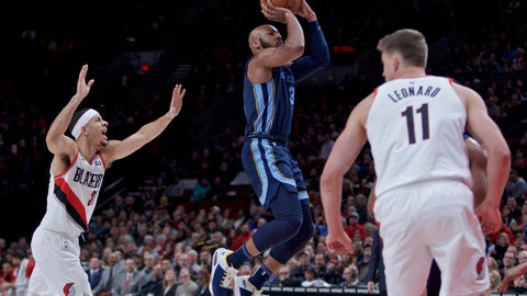 <p>               Memphis Grizzlies guard Jevon Carter, center, shoots over Portland Trail Blazers guard Seth Curry, left, and forward Meyers Leonard, right, during the first half of an NBA basketball game in Portland, Ore., Wednesday, Dec. 19, 2018. (AP Photo/Craig Mitchelldyer)             </p>