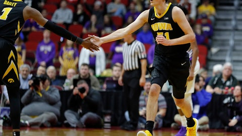 <p>               Iowa forward Nicholas Baer, right, high fives Iowa guard Maishe Dailey, left, after a Baer scored a 3-pointer against Northern Iowa during the first half of an NCAA college basketball game, Saturday, Dec. 15, 2018, in Des Moines, Iowa. (AP Photo/Matthew Putney)             </p>