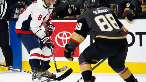 <p>               Washington Capitals left wing Alex Ovechkin (8) passes around Vegas Golden Knights defenseman Nate Schmidt (88) during the first period of an NHL hockey game Tuesday, Dec. 4, 2018, in Las Vegas. (AP Photo/John Locher)             </p>