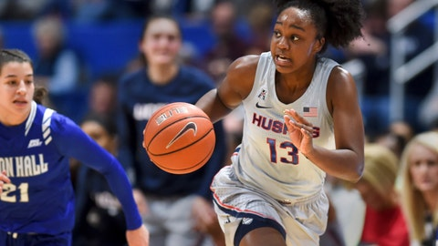 <p>               Connecticut's Christyn Williams (13) drives down the court in the first half of an NCAA college basketball game against Seton Hall, Saturday, Dec. 8, 2018, in Hartford, Conn. (AP Photo/Stephen Dunn)             </p>