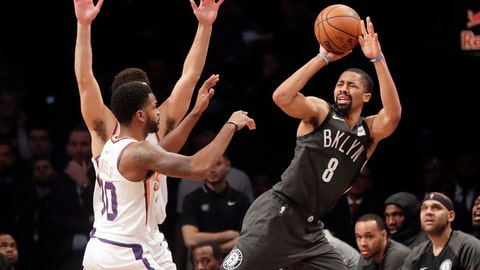 <p>               Brooklyn Nets' Spencer Dinwiddie (8) passes away from Phoenix Suns' Troy Daniels (30) during the first half of an NBA basketball game Sunday, Dec. 23, 2018, in New York. (AP Photo/Frank Franklin II)             </p>