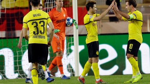 <p>               Dortmund's Raphael Guerreiro, second right, celebrates with teammate Mario Gotze, right, after scoring his side second goal during the Champions League group A soccer match between AS Monaco and Borussia Dortmund, in Monaco, Tuesday, Dec. 11, 2018. (AP Photo/Claude Paris)             </p>