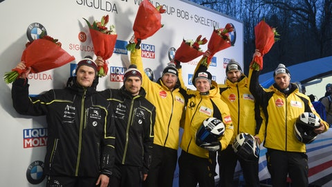 <p>               From left, Matiss Miknis and Oskars Kibermanis of Latvia, second place, Francesco Friedrich and Martin Grothkopp of Germany, first place, Christoph Hafer and Tobias Schneider of Germany, third place, celebrates on podium after men's two-man bobsleigh World Cup race in Sigulda, Latvia, Sunday, Dec. 9, 2018. (AP Photo/Roman Koksarov)             </p>