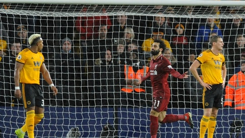 <p>               Liverpool's Mohamed Salah, centre, celebrates after scoring his side's opening goal during the English Premier League soccer match between Wolverhampton Wanderers and Liverpool at the Molineux Stadium in Wolverhampton, England, Friday, Dec. 21, 2018. (AP Photo/Rui Vieira)             </p>