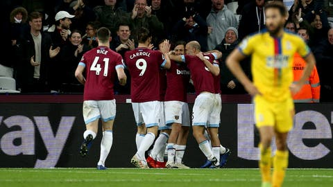 <p>               West Ham United's Robert Snodgrass, obscured, celebrates scoring his side's first goal of the game during their English Premier League soccer match against Crystal Palace at The London Stadium, London, Saturday, Dec. 8, 2018. (Yui Mok/PA via AP)             </p>