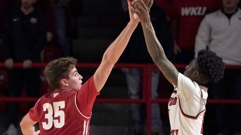 <p>               Wisconsin forward Nate Reuvers (35) tries to block the ball from Western Kentucky guard Taveion Hollingsworth during the first half of an NCAA college basketball game Saturday, Dec. 29, 2018, in Bowling Green, Ky. (AP Photo/Tim Broekema)             </p>