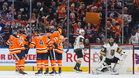 <p>               Edmonton Oilers celebrate a goal against the Vegas Golden Knights, as Golden Knights' Colin Miller (6) and goalie Marc-Andre Fleury (29) react during the third period of an NHL hockey game Saturday, Dec. 1, 2018, in Edmonton, Alberta. (Jason Franson/The Canadian Press via AP)             </p>