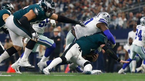<p>               Philadelphia Eagles quarterback Carson Wentz (11) is sacked by Dallas Cowboys defensive end Demarcus Lawrence (90) during the first half of an NFL football game, in Arlington, Texas, Sunday, Dec. 9, 2018. (AP Photo/Ron Jenkins)             </p>